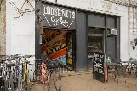 a line of bikes outside of Loose Nuts Cycles
