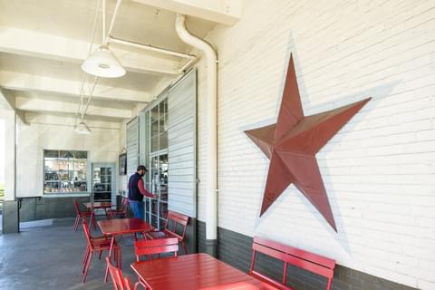 a big red star outside of Star Provisions
