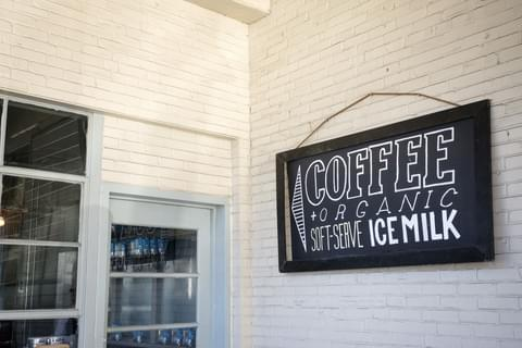 a simple sign outside of a coffee shop