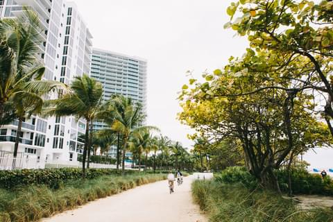 "Nicknamed the ""dream village,"" Bal Harbour is a small, oceanfront neighborhood on the northern tip of Miami Beach most famously known for its luxury hotels and outdoor retail center, the Bal Harbour Shops."